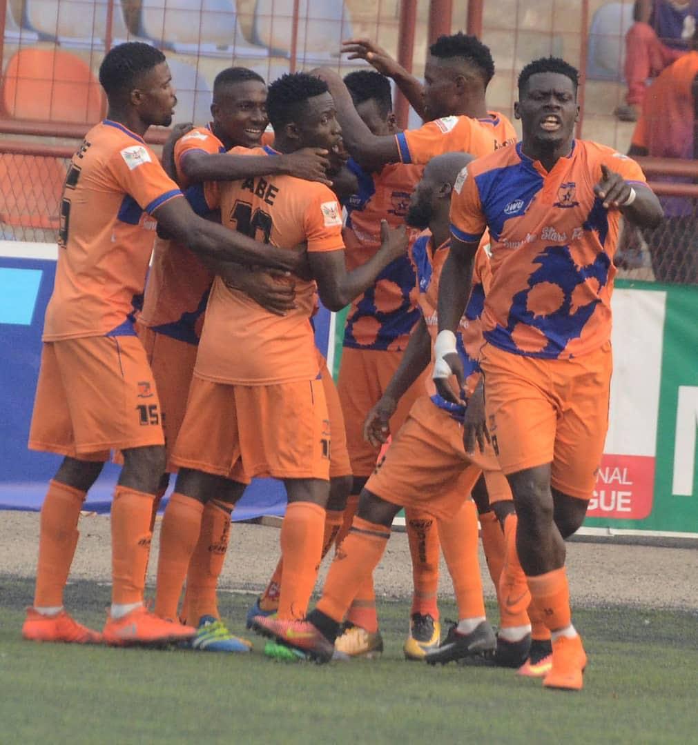 Ayo Adejubu celebrates with teammates - NPFL debut: Teenage sensation Adejubu feels no pressure