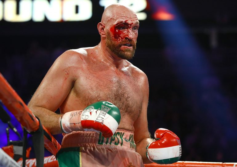 a bloodied Tyson Fury survives a severe cut to beat Otto Wallin - Fury makes worrying injury admission ahead of Deontay Wilder rematch