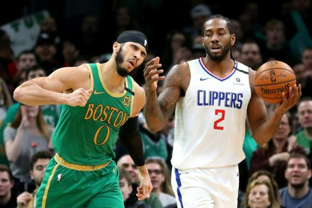 Bostons Jayson Tatum left reacts to a turnover by Kawhi Leonard of the Los Angeles Clippers on Thursday in Bostons 141 133 double overtime triumph - NBA: Tatum powers Celtics over Clippers in double overtime