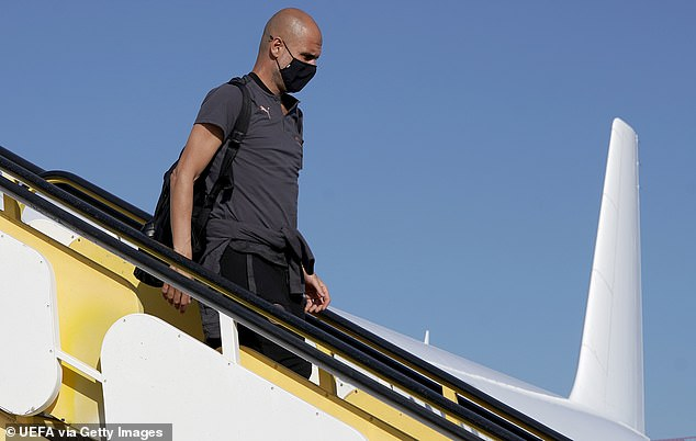 Pep Guardiola (pictured) landed in Lisbon on Monday for their quarter final