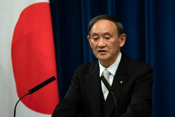 Japan PM Suga 'determined' to hold Olympics despite Covid-19