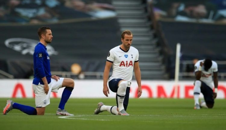 England and Tottenham striker Harry Kane (centre) takes a knee to highlight the issue of racial injustice