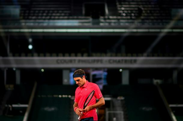 Roger Federer playing against Germany's Dominik Koepfer in an empty Court Philippe Chatrier