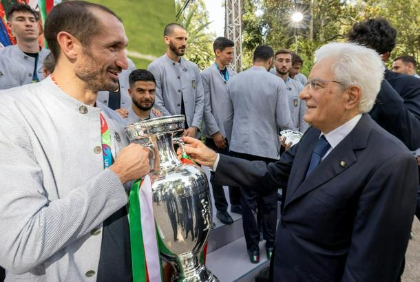 Italy's President Sergio Mattarella (R) congratulating captain Giorgio Chiellini on their Euro 2020 victory