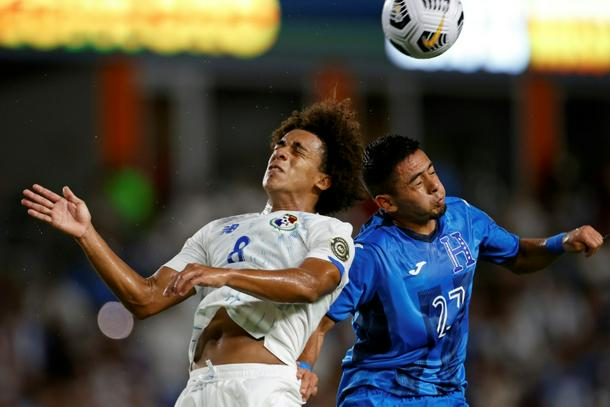 Panama midfielder Adalberto Carrasquilla (left) and Honduras defender Diego Rodriguez battle for a header during the CONCACAF Gold Cup in Texas
