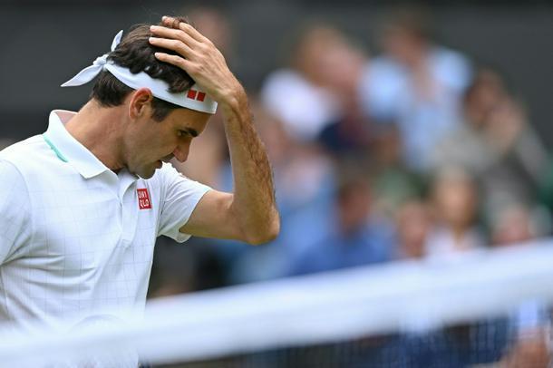 Roger Federer reacts to defeat against Poland's Hubert Hurkacz