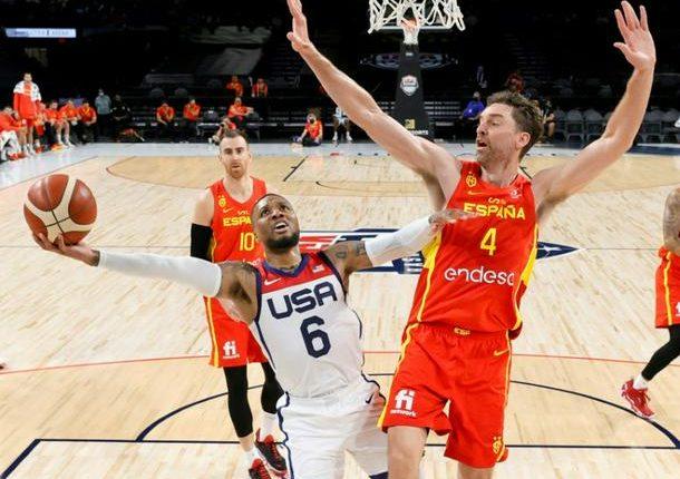 Team USA's Damian Lillard, left, shoots against Spain's Pau Gasol during an pre-Olympic exhibition game in Las Vegas